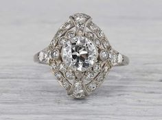 Antique Edwardian engagement ring made in platinum and centered with a GIA certified 1.01 carat old European cut diamond with J color and SI2 clarity. Circa 1915.