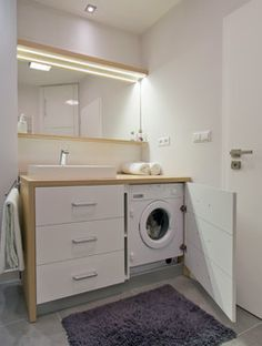 This bathroom makes good use of existing plumbing fixtures with a compact washer/dryer. however most standard cabinets are not as deep. this one uses a nice top..wonder where it's from