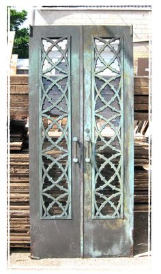 A beautiful pair of bronze doors that could be the entrance to my wine cellar
