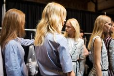 Backstage at the Yigal Azrouel show, hairstylist James Pecis for Bumble and Bumble saturated models' hair in texturizing product, twisted it into two sections, and clipped in the back to set. Once hair was air-dried, he let it loose for barely there, California-surfer-girl-inspired waves.