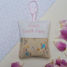 Peter Rabbit Tooth Fairy Pillow Bag by Tuppenny House Designs, the perfect gift for Explore more unique gifts in our curated marketplace. Peter Rabbit Fabric, Tooth Fairy Doors, Pillow Embroidery, Bed With Posts, Little Girl Gifts, Tooth Fairy Pillow, Pillows, Cushions, Teeth