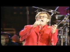 Queen Elton John and Tony Iommi - The Show Must Go On - YouTube