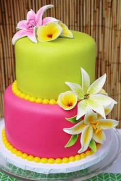 Pink and green cake at a Hawaii birthday party! See more party ideas at CatchMyParty.com!