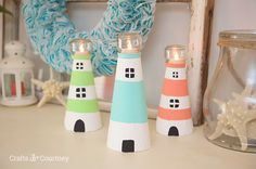 Mantel with Lighthouse Decor. DIY Lighthouse Ideas:  http://www.completely-coastal.com/2016/05/diy-lighthouses-how-to-make-lighthouse-cardboard-plastic-bottle-etc.html How to make decorative lighthouses from foam cones, cardboard, bottles, pots & more!
