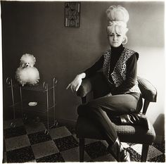 Diane Arbus - Lady bartender at home with a souvenir dog, New Orleans, 1964