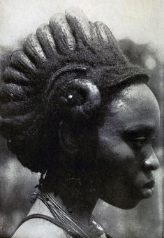 "ukpuru:  Hair-dressing as a Work of Art [Igbo] Charcoal dust and palm oil are freely used, bus should necessity arise the structure must be cut away entirely, as it cannot be ""undone"". Among the Ibos of Nigeria [Public Domain], G. T. Basden, early 20th century."