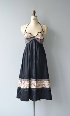 Vintage 1970s Young Edwardian black polished cotton sundress with floral print interesting notched neckline, cross back straps, empire waist, open back and back zip closure. --- M E A S U R E M E N T S --- fits like: small/medium bust: 35.5 waist: free hip: free length: 49 brand/maker: Young Edwardian condition: excellent to ensure a good fit, please read the sizing guide: http://www.etsy.com/shop/DearGolden/policy ✩ layaway is available for this item ✩...