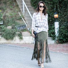 In an Aritzia top, The Perfext skirt, Stuart Weitzman heels and Prada sunglasses. Click through to shop her look!