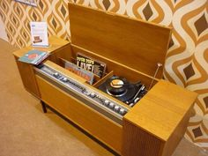 Life before internet news and music - a radiogram is piece of furniture that combined a radio and record player. The word radiogram is a portmanteau of radio and gramophone.