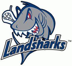 Columbus Landsharks Lacrosse Primary Logo (2001) - A shark holding a lacrosse stick