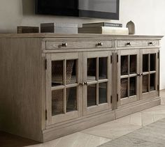 Livingston Small TV Stand – also has an option of only two open glass cabinets in the middle and drawers on the outside