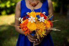 Bright yellow, orange, blue and white bouquet | Annmarie Sculpture Garden and Arts Center in Maryland | Photographer: The Madious