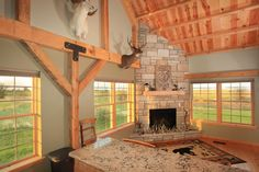 Stone Fireplace in a Barn Home - Perfect place to relax! | Sand Creek Post  Beam  https://www.facebook.com/SandCreekPostandBeam