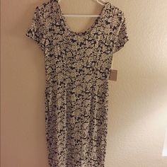 Floral tie up midi dress Calf length beautiful dress. Too small on me and got at a pop up boutique in Santa Monica. Brand new never been worn. Super cute with some docs & a hat Dresses Midi