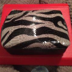 Zebra makeup bag Has zipper top enclosure. Never been used. Accessories