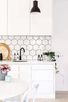 white modern kitchen geometric backsplash