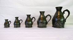 Set of 5 rare Irish pewter tavern measures.  1st quarter 19th century. All Measures marked with with owners mark.  Name on each piece.  Some wear from use.$1,500.00