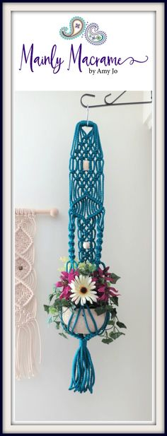 Small macrame plant hanger in sapphire with cream beads. These are great wall hanging planters as well.