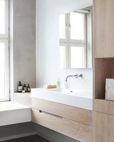Modern & minimal bathroom design by Haptic Architects ✨ European Oak joinery, polished concrete & white corian  by Inger Marie Grini