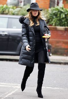 Abbey Clancy.. black on black maternity chic.. with Sergio Rossi matrix suede over-the-knee boots..