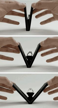 Ring box that opens and spins the ring like a blooming flower