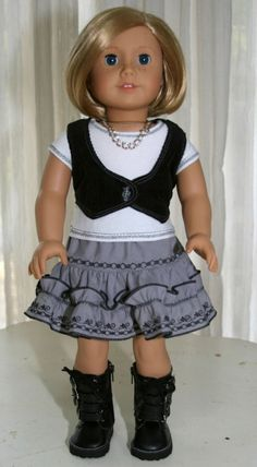 Lined corduroy vest with double top stitching and a working button, a T-shirt with decorative stitching on the hem, neck, and sleeves (closes with velcro), and a tiered broadcloth skirt of bias-cut ruffles with machine embroidery and an elasticized waist.| Trendy Spring Doll Outfit fits 18 Inch by Forever18Inches