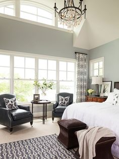 I love the natural light in this bedroom and the gray walls are a perfect contrast to the white trim and light.