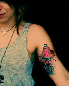 Butterfly Watercolor tattoo on girl's arm