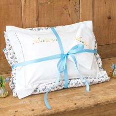 Blue ducks ultimate baby bundle. A very special gift set including a blue duck printed cot quilt and a baby pillowcase and baby blanket hand embroidered with yellow ducks. Available with or...