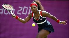 Serena Williams of the USA plays a forehand during the women's Singles Tennis match against Urszula Radwanska of Poland on Day 3 of the London 2012 Olympic Games at Wimbledon