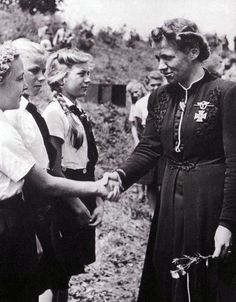 Hanna Reitsch with Jungmadel madchen,Hanna was a German aviator, Nazi test pilot, and the only woman awarded the Iron Cross First Class and the Luftwaffe Pilot/Observer Badge in Gold with Diamonds during World War II.