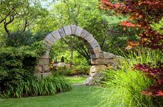 """Moon gate, built of unmortared granite blocks, built in 1996 by Dave Araneo of Massachusetts. """"It's is one of the oldest technologies around,"""" Dave says. """"You build a wood form, place the stones to either side, and build up. Then you finish with a keystone and remove the form."""