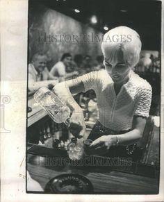 Cool 70's female bartender pic