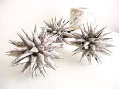 Paper urchin Christmas ornaments. (Also known as Polish Stars.) I grew up with these, but never quite mastered the rolling technique.
