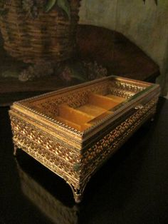 Golden jewelry box, an Art Deco ormolu filigree brass, beveled glass flip top cover sectional casket. textile velvet line. aged, excellent, normal wear, footed.