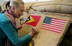 U.S. Secretary of State Hillary Rodham Clinton autographs a coffee bean sack while visiting the Timor Coffee Cooperative in Dili, East Timor Thursday, Sept. 6, 2012. (AP Photo/Jim Watson, Pool) ▼6Sep2012AP|Clinton in East Timor on democracy push http://bigstory.ap.org/article/clinton-east-timor-democracy-push #Dili #East_Timor #Timor_Lorosae #Hillary_Clinton