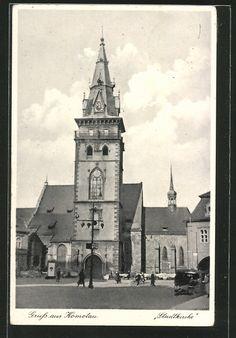 old postcard: AK Komotau / Chomutov, Blick zur Stadtkirche, Radfahrer