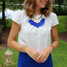 White pleated blouse with Stella & Dot Plume necklace