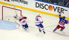 May 25, 2014; New York, NY, USA; New York Rangers right wing Martin St. Louis (26) celebrates after scoring the game-winning goal past Montreal Canadiens goalie Dustin Tokarski (35) and defenseman Alexei Emelin (74)  during the overtime period in game four