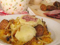 "Potato dumplings filled with meat, served with sauerkraut  - "" Zemiakove gule"" (Slovak language)"