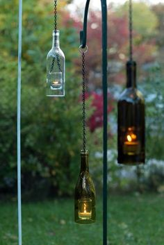Cute! Wine bottle lanterns to decorate the back porch area.
