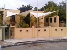 Installatie van 2 Zonz sunsails schaduwdoeken op Curacao! www.zonz.nl