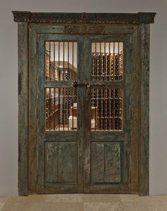 Antique doors lead to wine cellar.....I looooove these doors!