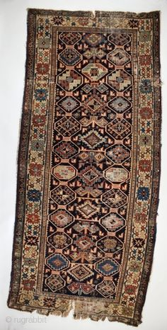 Love of Imperfection: To me, this rug has a mysterious nobility. Caucasian, I would guess. It has that Shirvan/Kuba look. Yet, it is clearly not one of the thousands manufactured in this ...