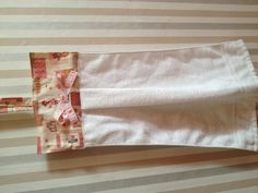 a simple kitchen towel. i bought a plain white towel and attatched(sewing) a scrap fabric on it.