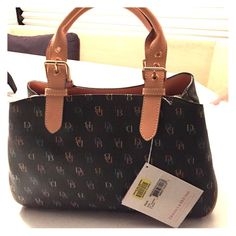 Dooney & Bourke Purse Brand new NEVER used D&B purse! One zipper in the middle with numerous pockets inside the zipper pocket. There are also two side pockets both opposite of the zipper (as shown in picture). Interior lining is a baby blue color Dooney & Bourke Bags