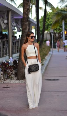 This top with wide legged pants a black Gucci bag.