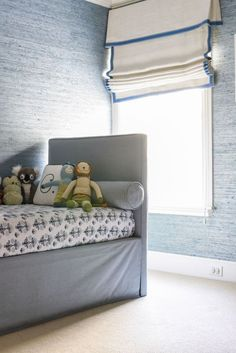 boys room with blue grasscloth wall covering