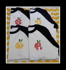 These are navy/white and black/white raglan tees with red and gold/yellow apples.