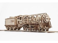 460 STEAM LOCOMOTIVE WITH TENDER    The UGEARS 460 Locomotive with Tender combines all of the technical and artistic innovations that builders have come to appreciate in our other models and takes them a step beyond. Richly detailed with an eye toward realism and romance, our version of this indelible symbol of 19th century technology and adventure captures the imagination of all who see it. It's no wonder it was such a hit during our Kickstarter campaign.    Our locomotive is driven by…